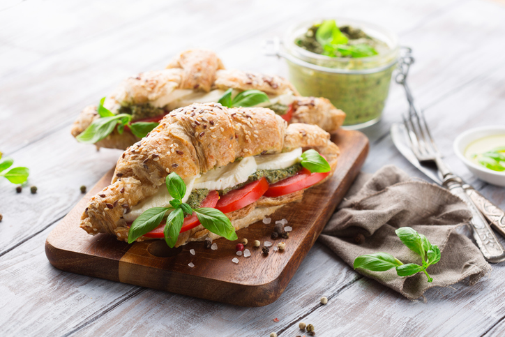 Croissants with mozzarella cheese, tomato and basil