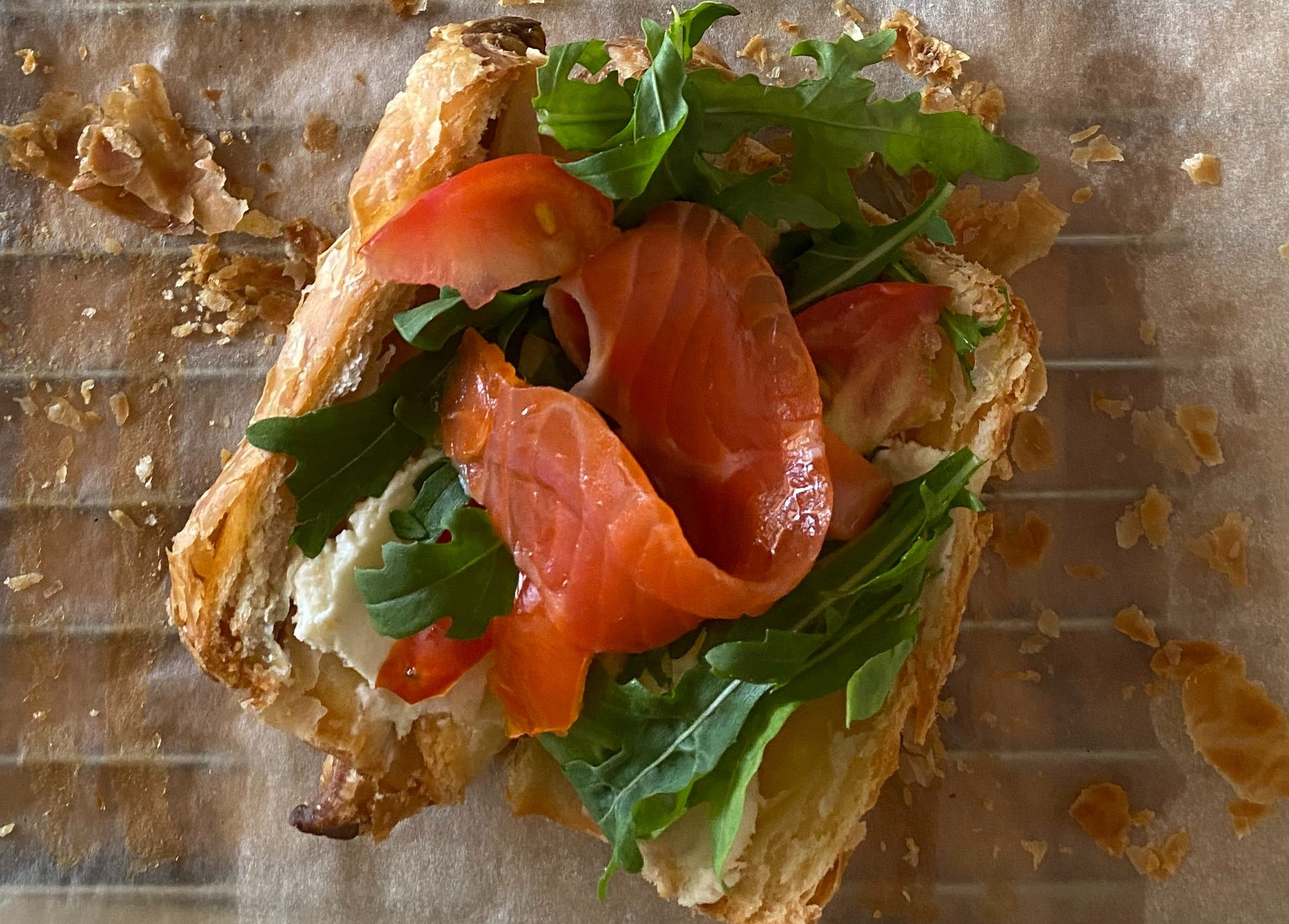 Wholegrain croissant filled with smoked salmon, soft cheese and rocket